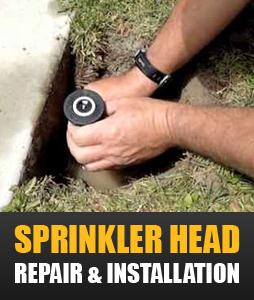 a tech is installing a new sprinkler head