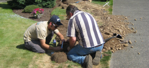 two Davie sprinkler repair technicians are install a new irrigation system
